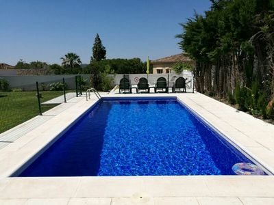 Photo for Sleeps 12, Private Heated Swimming Pool, Air Con, Wifi, Large Private Garden