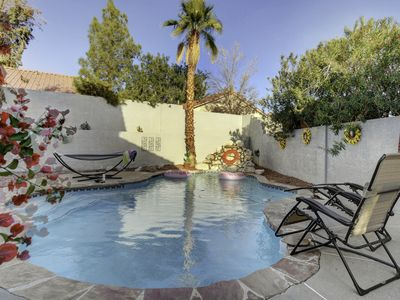 Charming home in suburban neighborhood w private pool.3 comfy bedrooms & 3 baths