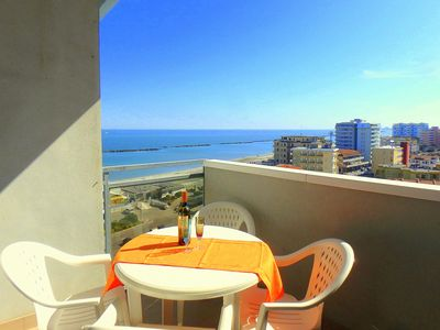 Photo for Lunch with a breathtaking view! Beachfront apartment in the center of Lido di Pomposa