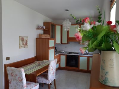 Photo for Apartment  with lake view, swimming pool, private garage and private garden.
