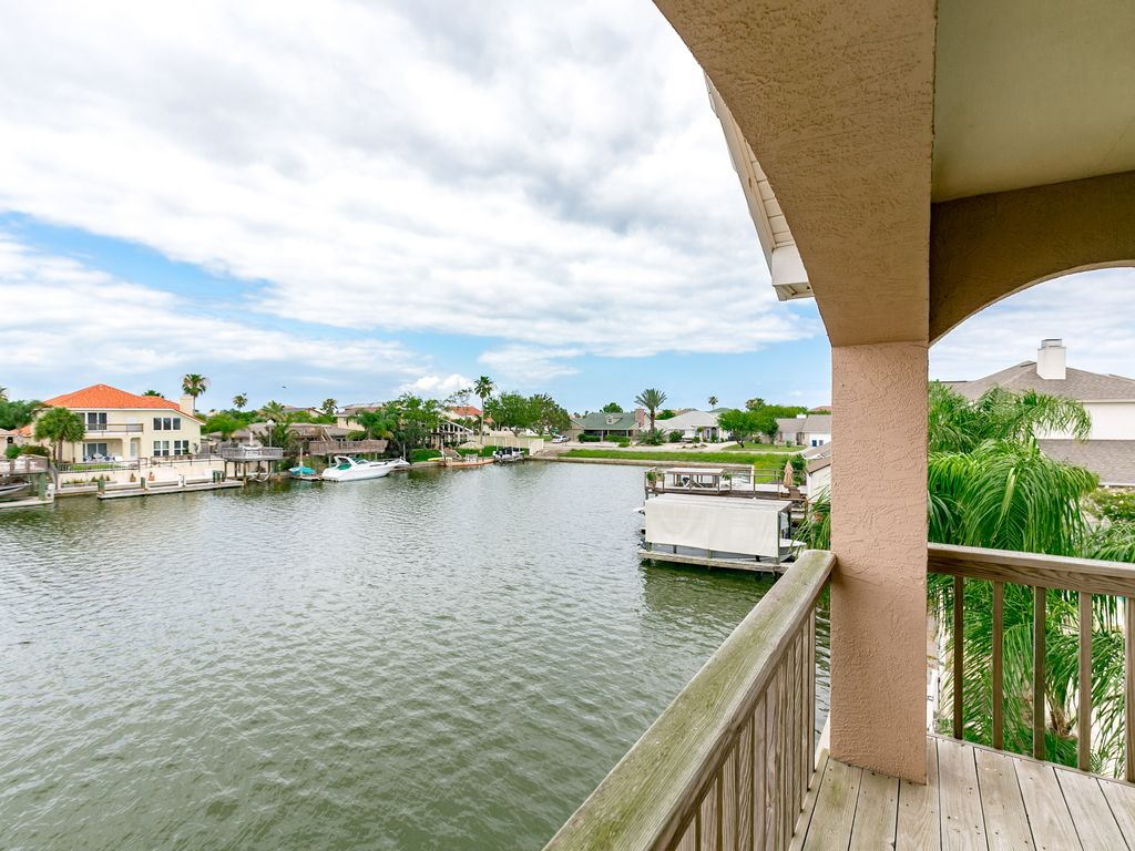 Show virtual tour canal kitchen living room pool - Balcony Two Levels Of Outdoor Living Space And Canal Views