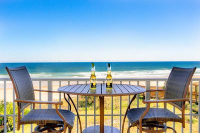 Relaxing on oceanfront balcony with awesome views