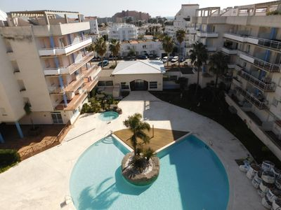 Photo for Duplex apartment with terrace, communal pool and parking, Roses