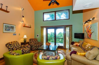 Ground floor living room has plenty of seating and views of mountain sunset.