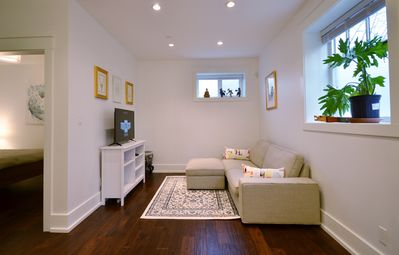 Photo for Cosy and clean, high ceilings, heated floors,  W/D in the heart of kits. 30d/min
