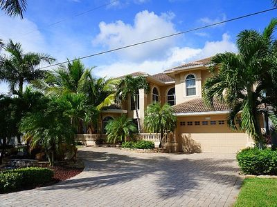 Photo for Palm Villa - This gorgeous estate home is embedded in mature palm trees and tropical foliage. Locate