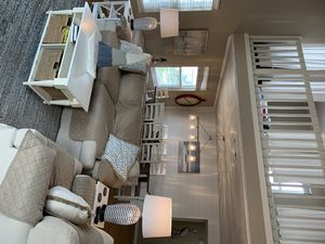 Living room/dining room combination is roomy and inviting.