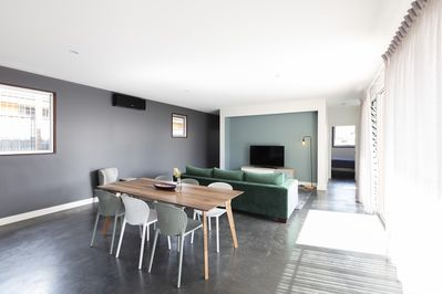 Dining facing lounge area. Bedroom to the right of TV & Bedroom to the left !