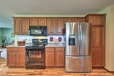 Large kitchen includes full size refrigerator with ice and water in the door.