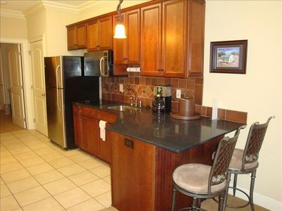 Full kitchen perfect for extended stay.