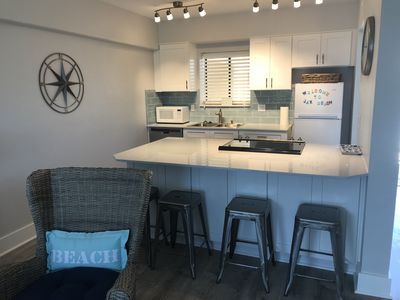 New kitchen with quartz island with seating for 4
