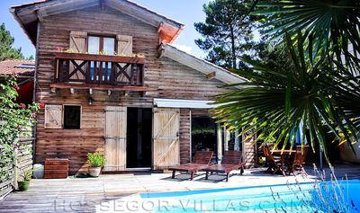 Photo for DIPLADENIA Wooden house with pool on the edge of the forest