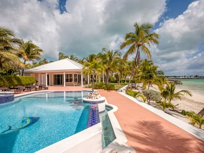Photo for Emerald Moon Beachfront Cottage with infinity pool- Sunrise Bay, Marsh Harbour
