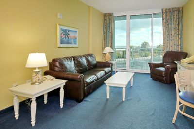 Oceanfront living room - Watch the dolphins play. Living room is direct oceanfront with private oceanfront balcony.
