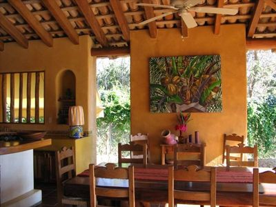 Breakfast at the bar or around the huge Parota wood dining table