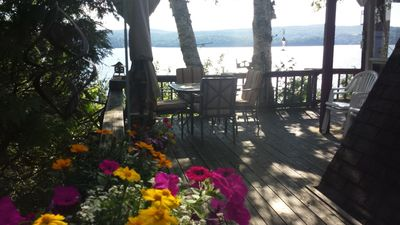 View of lake from top deck. Outside table seats 4 with an extra table available for more guests