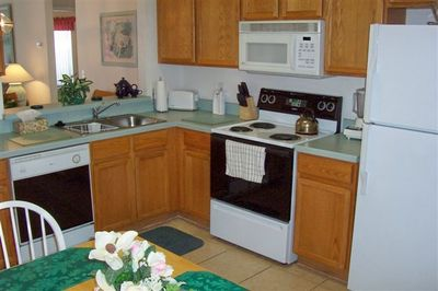 The bright fully equipped Kitchen.