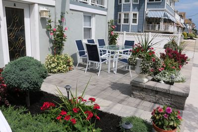 Beautiful front patio showing entrance to Condo A, our handicap friendly unit!