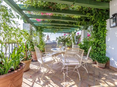 Photo for Charming one-bedroom apartment opening onto a pretty Andalusian patio