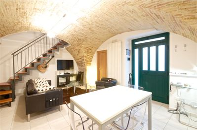 The vaulted brick ceiling & pillar is original to this century old property