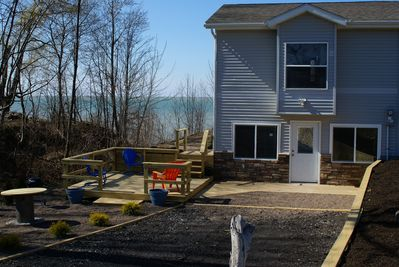 Front view of 1/2 of the house and lower deck. This entrance is at ground level.