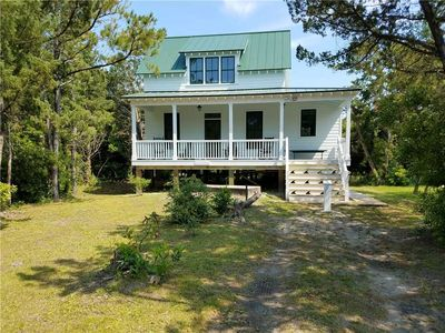 Photo for Nunc Pro Tunc:  Charming vacation home with covered and screened porch