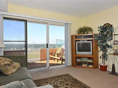 Photo for FREE DAILY ACTIVITIES!!! BEAUTIFUL SUNSETS!! OUTDOOR POOL & SMALL BOAT DOCK.  Beautiful sunset from this Bayside first floor 1 bedroom 1 bath, condo