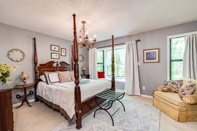 Our exquisite master suite with window seat which overlooks the woods.