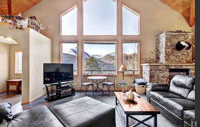 Relax on the 10 person leather sofa, 4K TV, perfect framed 14'er form every room