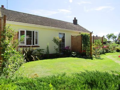 Photo for Pretty, cosy, all ground level cottage with sunny enclosed south facing garden.