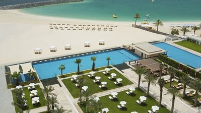 """""""View of Al Bateen pool area and beach to the right from lower floor"""