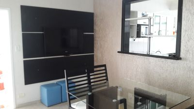 Photo for apartment guaruja fds and season 3 bedrooms a50m from the beach