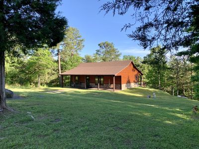 Beautiful log style cabin on heavily wooded 2.8 acre lot. 2 Bed/1 Bath, Sleeps 6