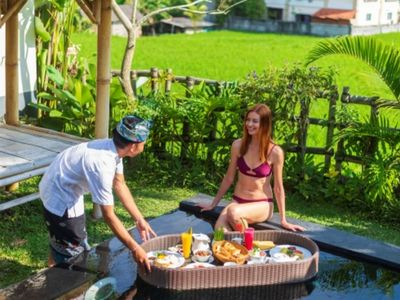 Photo for Private pool with tropical garden, overlooking the stunning rice paddies