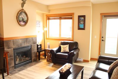 Large living area with built-in gas fireplace
