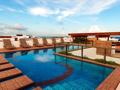 Photo for NEW LISTING! Luxurious condo w/ shared pool & modern kitchen - 3 blocks to beach