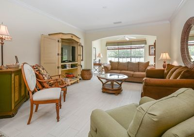 Spacious living area with a lovely view of the pond and golf course.