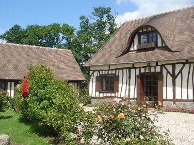 Photo for Norman thatched cottage, sleeps 5, in the countryside and near the sea