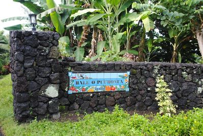 Tile address sign to the right of the driveway.