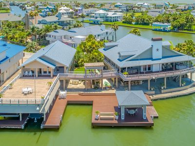 Photo for NEW LISTING! Bayfront retreat w/sunset views, fishing lights & outdoor kitchen!