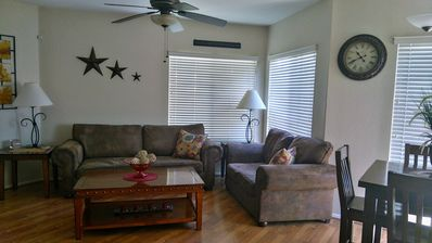 Large living room space with laminate flooring