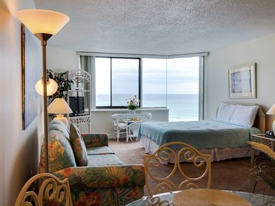 Photo for Oceanfront condo w/ ocean views & shared pool - snowbirds welcome!