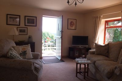 Comfortable Lounge Area with access straight onto the balcony with stunning view