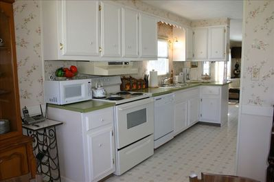 Kitchen with stove/oven, refrigerator, dishwasher, dishes, utensils, pot & pans