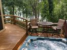 HOT TUB DECK OVERLOOKS LAKE WITH LOUNGE AREA