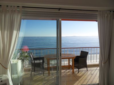 Photo for Luxury apartment with stunning seaview  at the waterfront, internet, air-cond.