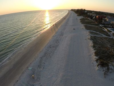 Photo for SPRING SPECIALS & SAVE$, MILE PRIVATE BEACH, CHAIRS, WIFI, 2 MIN TOWN JOHNS PASS