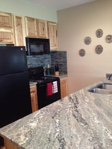 Beautiful kitchen with granite counter tops, brand new appliances and cabinets