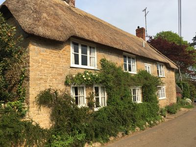 Photo for Idyllic thatched cottage,  Jurassic coast, walking distance to 2 great pubs.