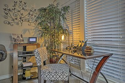 This condo offers a desk and printer for the traveling businessmen.